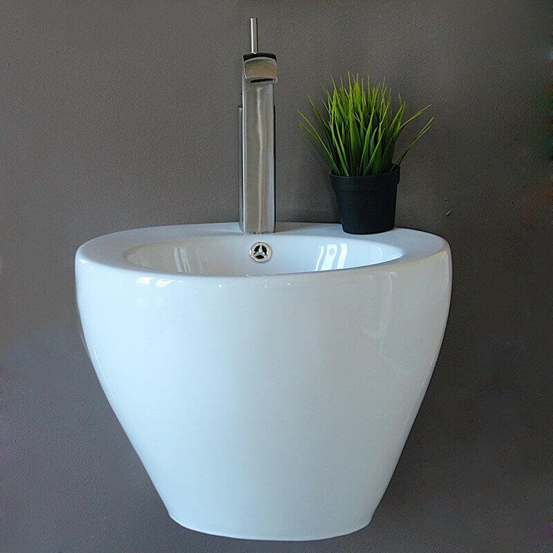 Vasque Céramique à Suspendre Avec Plage Latérale : Lavabo rond céramique style suspendu